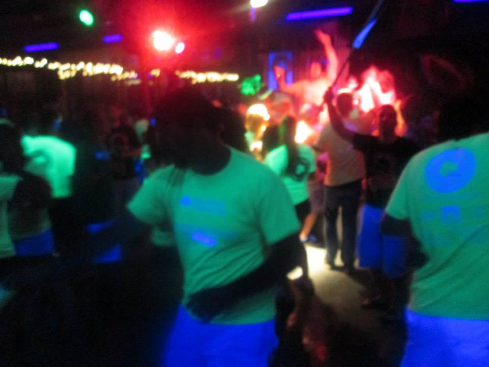 Our shirts changed colors in the lights upstairs at Gemstones!